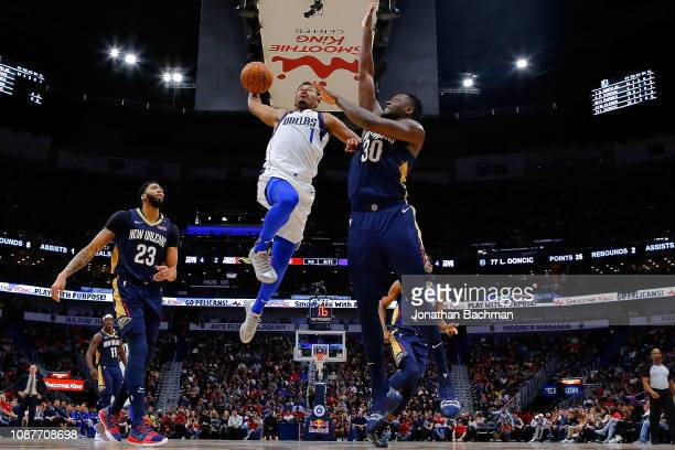 Dennis Smith Jr #1 of the Dallas Mavericks shoots against Julius Randle of the New Orleans Pelicans during the second half at the Smoothie King...