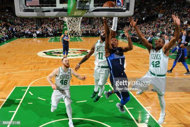 Dennis Smith Jr #1 of the Dallas Mavericks shoots the ball against the Milwaukee Bucks on December 6 2017 at the TD Garden in Boston Massachusetts...