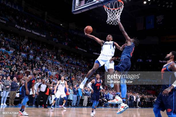 Dennis Smith Jr #1 of the Dallas Mavericks shoots the ball to give the Dallas Mavericks the lead late in the 4th quarter against the Oklahoma City...