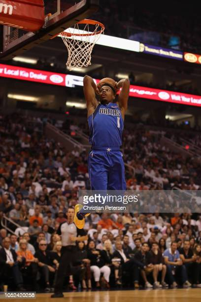 Dennis Smith Jr #1 of the Dallas Mavericks slam dunks the ball against the Phoenix Suns during the first half of the NBA game at Talking Stick Resort...
