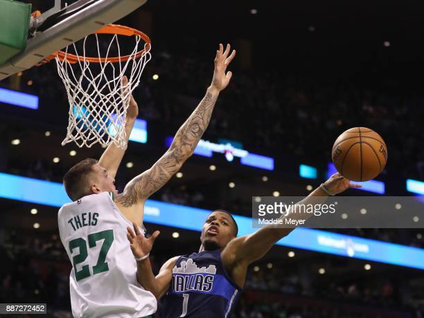 Dennis Smith Jr #1 of the Dallas Mavericks takes a shot against Daniel Theis of the Boston Celtics during the second quarter at TD Garden on December...