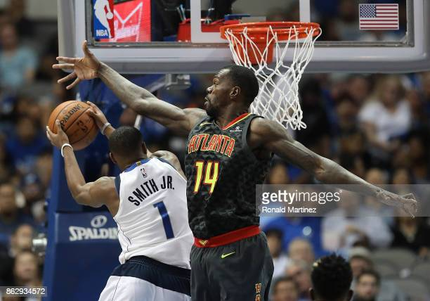 Dennis Smith Jr #1 of the Dallas Mavericks takes a shot against Dewayne Dedmon of the Atlanta Hawks in the second half at American Airlines Center on...