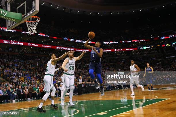 Dennis Smith Jr #1 of the Dallas Mavericks takes a shot over Aron Baynes of the Boston Celtics during the first quarter at TD Garden on December 6...