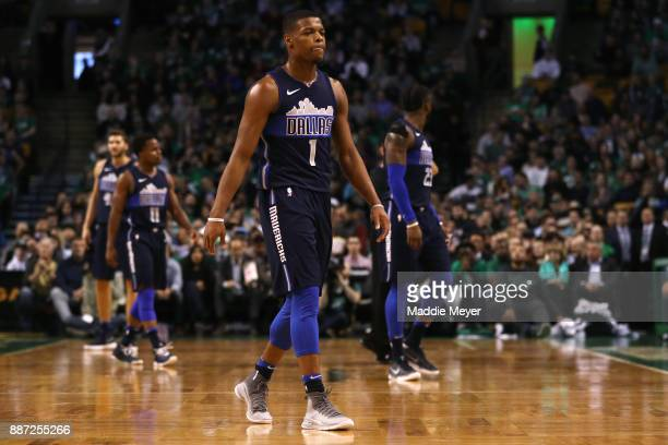 Dennis Smith Jr #1 of the Dallas Mavericks walks to the bench during the first quarter against the Boston Celtics at TD Garden on December 6 2017 in...