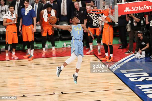 Dennis Smith Jr #1 of the USA Team goes up for a dunk against the World Team during the Mountain Dew Kickstart Rising Stars Game during AllStar...
