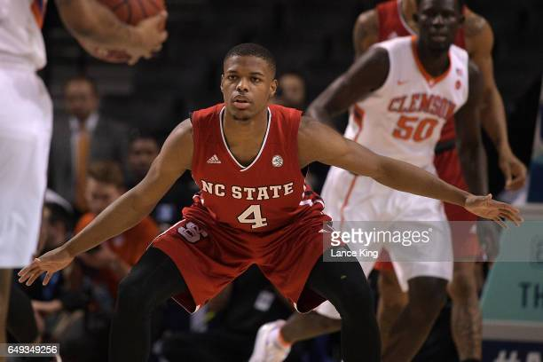 Dennis Smith Jr #4 of the North Carolina State Wolfpack defends during their game against the Clemson Tigers during the first round of the ACC...