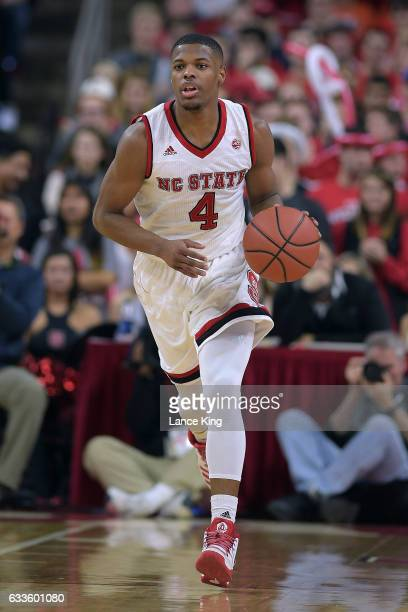 Dennis Smith Jr #4 of the North Carolina State Wolfpack dribbles up court against the Syracuse Orange at PNC Arena on February 1 2017 in Raleigh...