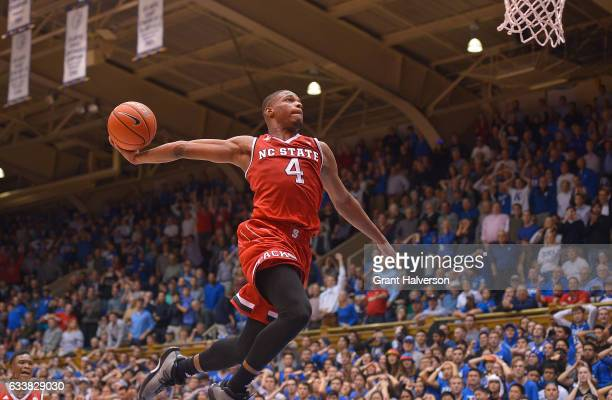Dennis Smith Jr #4 of the North Carolina State Wolfpack drives in for an emphatic dunk after time expires during their win against the Duke Blue...