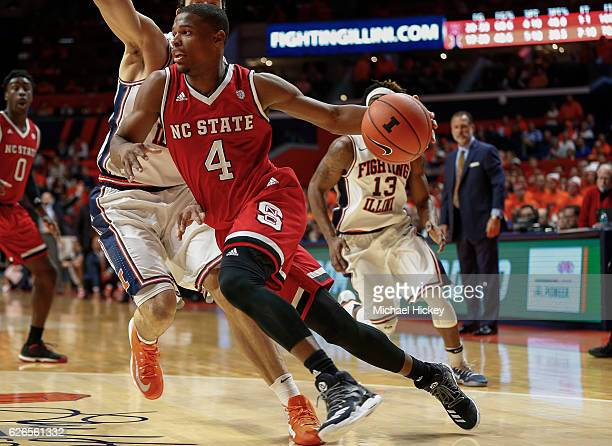 Dennis Smith Jr #4 of the North Carolina State Wolfpack drives to the basket during the game against the Illinois Fighting Illini at State Farm...