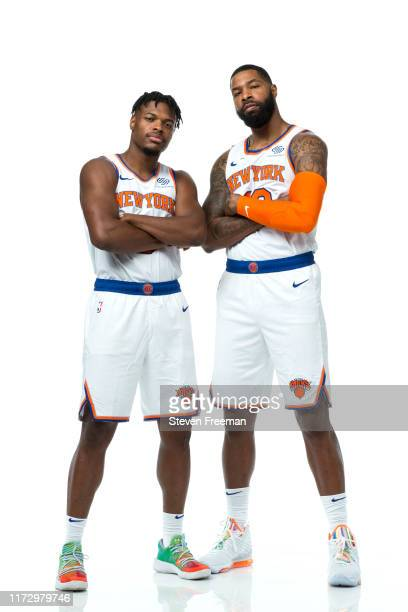 Dennis Smith Jr #5 and Marcus Morris of the New York Knicks pose for a portrait during media day on September 30 2019 at the Madison Square Garden...