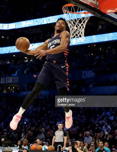 Dennis Smith Jr #5 of the New York Knicks attempts a dunk during the ATT Slam Dunk as part of the 2019 NBA AllStar Weekend at Spectrum Center on...
