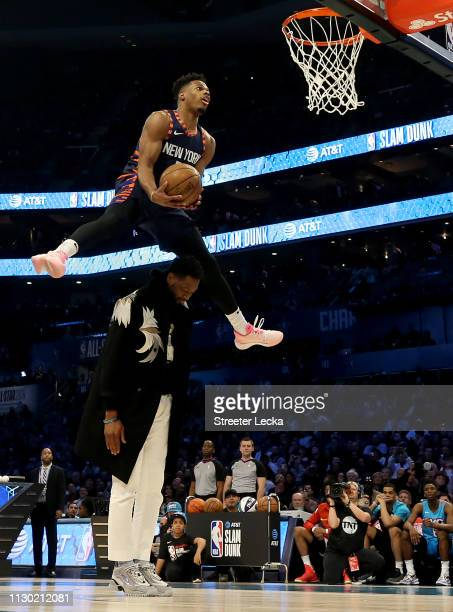 Dennis Smith Jr #5 of the New York Knicks attempts a dunk over Dwyane Wade during the ATT Slam Dunk as part of the 2019 NBA AllStar Weekend at...