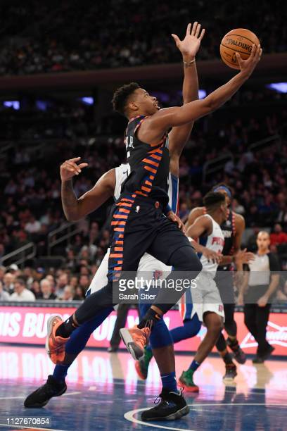 Dennis Smith Jr #5 of the New York Knicks attempts a layup during the third quarter of the game against the Detroit Pistons at Madison Square Garden...