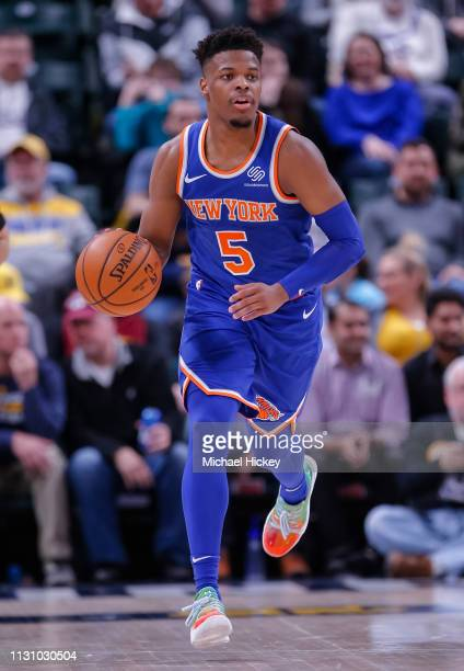 Dennis Smith Jr #5 of the New York Knicks brings the ball up court during the game against the Indiana Pacers at Bankers Life Fieldhouse on March 12...