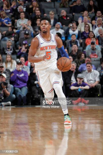 Dennis Smith Jr #5 of the New York Knicks brings the ball up the court against the Sacramento Kings on March 4 2019 at Golden 1 Center in Sacramento...