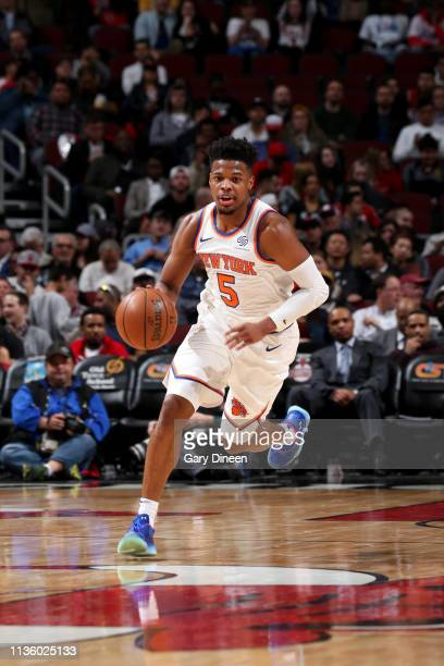 Dennis Smith Jr #5 of the New York Knicks brings the ball up the court against the Chicago Bulls on April 9 2019 at the United Center in Chicago...