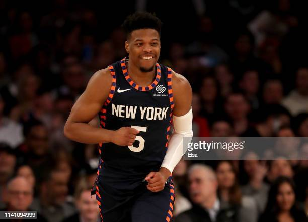 Dennis Smith Jr #5 of the New York Knicks celebrates his shot in the first half against the Washington Wizards at Madison Square Garden on April 07...