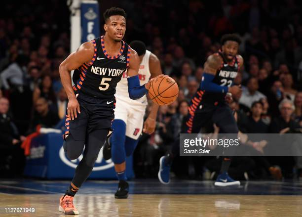 Dennis Smith Jr #5 of the New York Knicks dribbles down the court during the third quarter of the game against the Detroit Pistons at Madison Square...