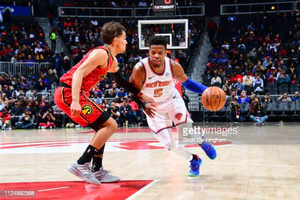 Dennis Smith Jr #5 of the New York Knicks drives past Trae Young of the Atlanta Hawks on February 14 2019 at State Farm Arena in Atlanta Georgia NOTE...