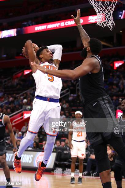 Dennis Smith Jr #5 of the New York Knicks drives to the basket against Andre Drummond of the Detroit Pistons during the first half at Little Caesars...