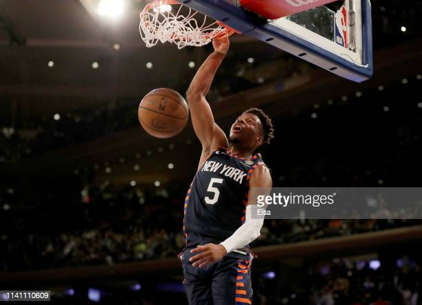 Dennis Smith Jr #5 of the New York Knicks dunks at the buzzer to end the game against the Washington Wizards at Madison Square Garden on April 07...