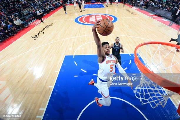 Dennis Smith Jr #5 of the New York Knicks dunks the ball against the Detroit Pistons on February 8 2019 at Little Caesars Arena in Detroit Michigan...