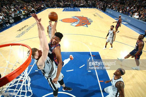 Dennis Smith Jr #5 of the New York Knicks dunks the ball against the San Antonio Spurs on February 24 2019 at Madison Square Garden in New York City...
