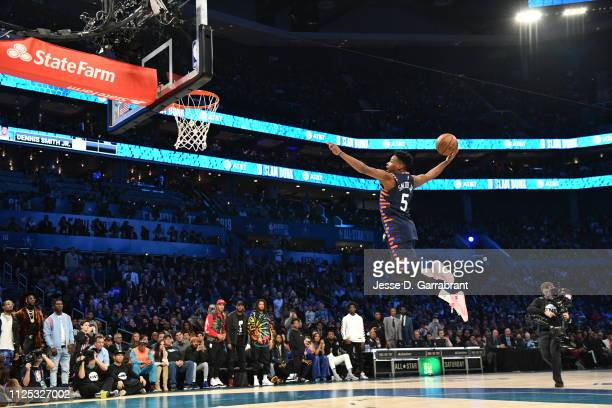 Dennis Smith Jr #5 of the New York Knicks dunks the ball during the 2019 ATT Slam Dunk Contest during the 2019 ATT Slam Dunk Contest as part of the...