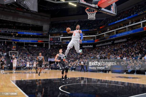 Dennis Smith Jr #5 of the New York Knicks dunks the ball during the game against the Sacramento Kings on March 4 2019 at Golden 1 Center in...