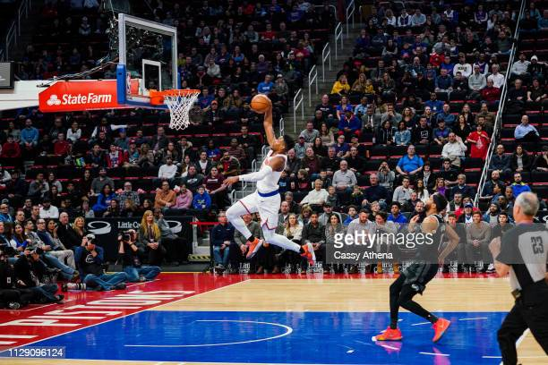 Dennis Smith Jr #5 of the New York Knicks dunks the ball in a game against the Detroit Pistons at Little Caesars Arena on February 08 2019 in Detroit...