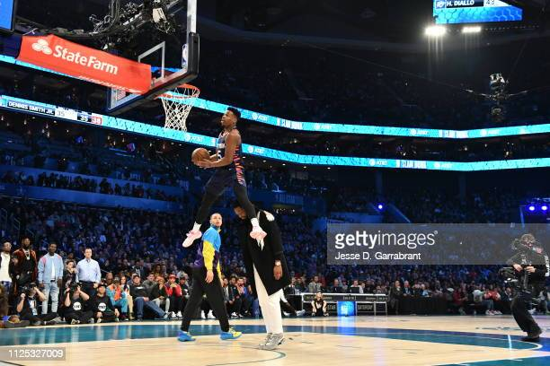 Dennis Smith Jr. #5 of the New York Knicks dunks the ball over Dwyane Wade of the Miami Heat during the 2019 AT&T Slam Dunk Contest during the 2019...