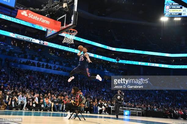 Dennis Smith Jr #5 of the New York Knicks dunks the ball over J Cole during the 2019 ATT Slam Dunk Contest during the 2019 ATT Slam Dunk Contest as...