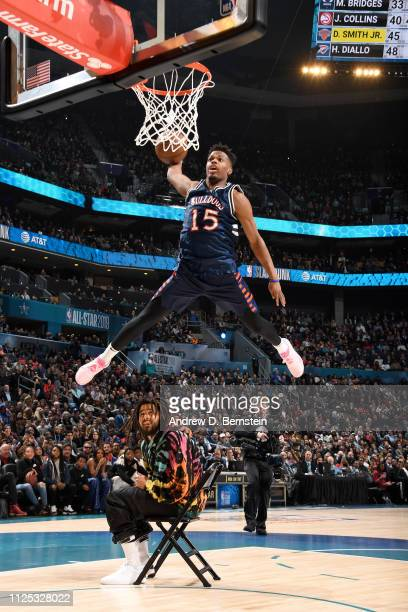 Dennis Smith Jr #5 of the New York Knicks dunks the ball over J Cole during the 2019 ATT Slam Dunk Contest as part of the State Farm AllStar Saturday...