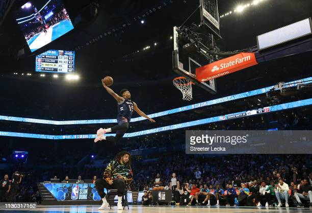 Dennis Smith Jr #5 of the New York Knicks dunks the ball over over J Cole during the ATT Slam Dunk as part of the 2019 NBA AllStar Weekend at...