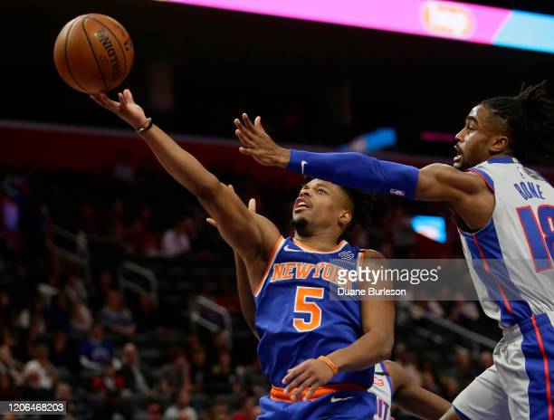 Dennis Smith Jr #5 of the New York Knicks goes to the basket against Jordan Bone of the Detroit Pistons during the first half at Little Caesars Arena...