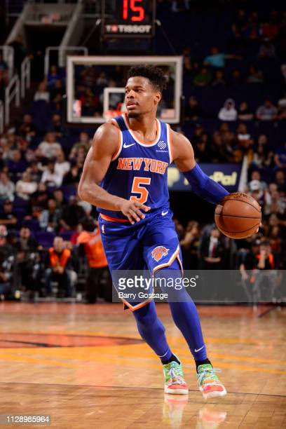 Dennis Smith Jr #5 of the New York Knicks handles the ball against the Phoenix Suns on March 6 2019 at Talking Stick Resort Arena in Phoenix Arizona...