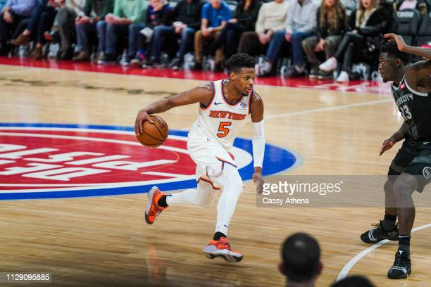 Dennis Smith Jr #5 of the New York Knicks handles the ball in a game against the Detroit Pistons at Little Caesars Arena on February 08 2019 in...