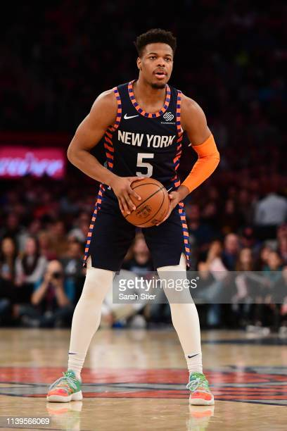 Dennis Smith Jr #5 of the New York Knicks looks to pass during the second half of the game against the Miami Heat at Madison Square Garden on March...