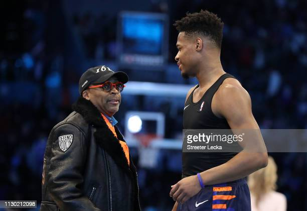 Dennis Smith Jr #5 of the New York Knicks talks with director Spike Lee after the ATT Slam Dunk as part of the 2019 NBA AllStar Weekend at Spectrum...