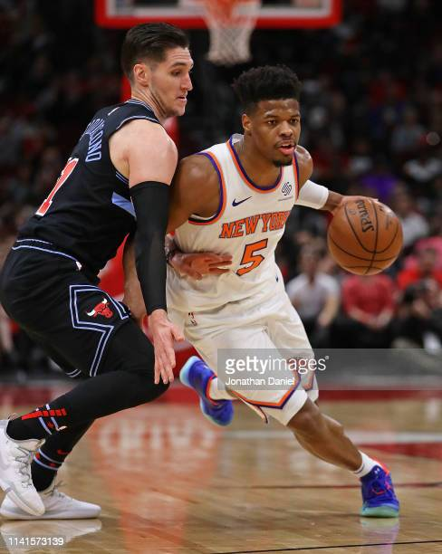 Dennis Smith Jr #5 of the New York Knicksdrives against Ryan Arcidiacono of the Chicago Bulls at the United Center on April 09 2019 in Chicago...