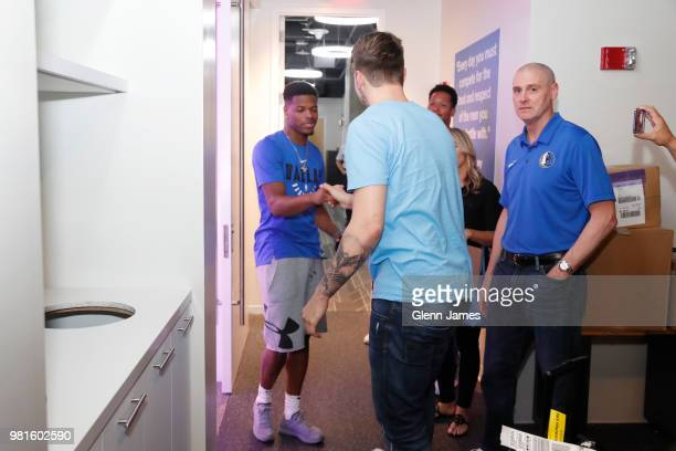 Dennis Smith Jr exchanges handshakes with Draft Pick Luka Doncic prior to the Post NBA Draft press conference on June 22 2018 at the American...