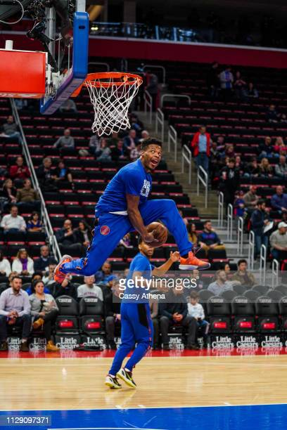 Dennis Smith Jr of the New York Knicks dunks the ball in warm ups before a game against the Detroit Pistons at Little Caesars Arena on February 08...