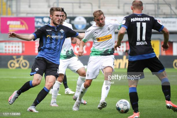 Dennis Srbeny and Sven Michel of SC Paderborn 07 and Tony Jantschke of Borussia Moenchengladbach battle for the ball during the Bundesliga match...