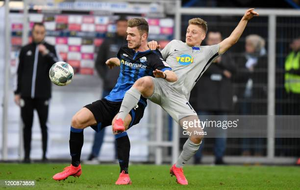 Dennis Srbeny of SC Paderborn and Santiago Ascacibar of Hertha BSC during the game between the SC Paderborn 07 against Hertha BSC on february 15 2020...