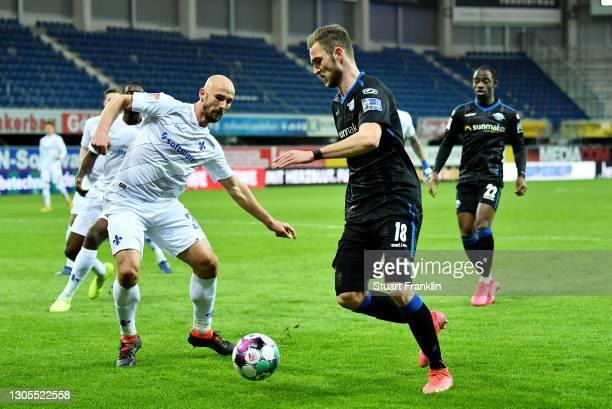 Dennis Srbeny of SC Paderborn battles for possession with Patrick Herrmann of SV Darmstadt 98 during the Second Bundesliga match between SC Paderborn...