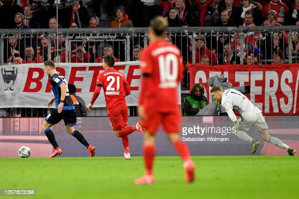 Dennis Srbeny of SC Paderborn passes Manuel Neuer of Bayern Munich before scoring his team first goal during the Bundesliga match between FC Bayern...