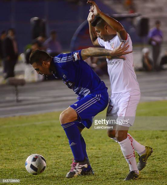 Dennis Stracqualursi of Emelec fights for the ball with Luis Romero of Liga de Quito during a match between Emelec and LDU Quito as part of...