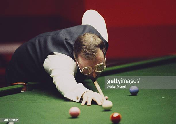 Dennis Taylor of Northern Ireland lines up the cue ball during his World Snooker Championship final match against Steve Davis on 28 April 1985 at the...