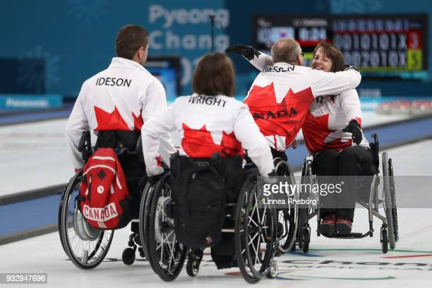 Dennis Thiessen Marie Wright Mark Ideson and Ina Forrest of Canada reacts after winning the Curling Mixed Bronze Medal match between South Korea and...