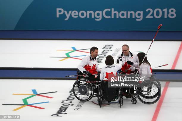 Dennis Thiessen Marie Wright Mark Ideson and Ina Forrest of Canada gather in a circle during the Curling Mixed Bronze Medal match between South Korea...
